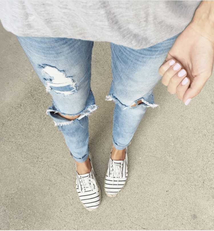distressed jeand and sneakers
