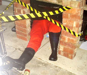 Chris' photo of Santa's legs coming out of their handbuilt chimney