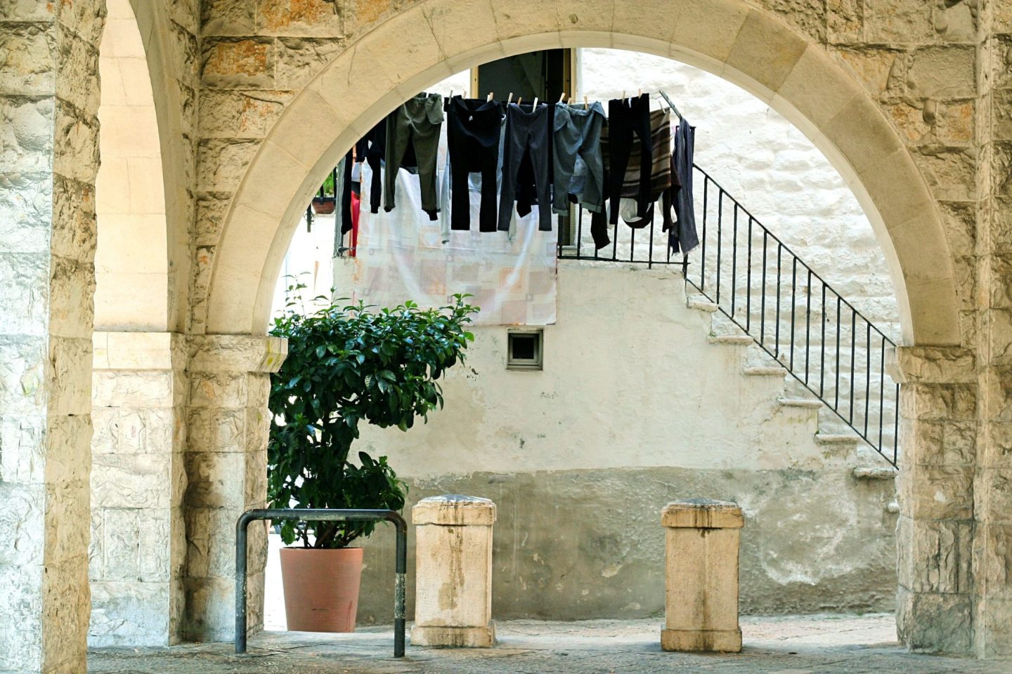 Black laundry hanging on the line in Bari old town, Italy