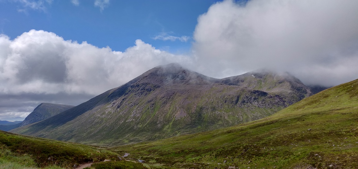 Munro mountains in Cairngorms with clouds.