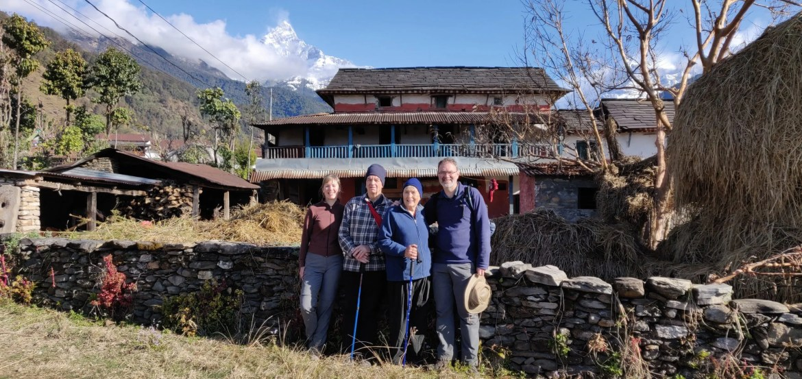Western family outside house in Gurung village