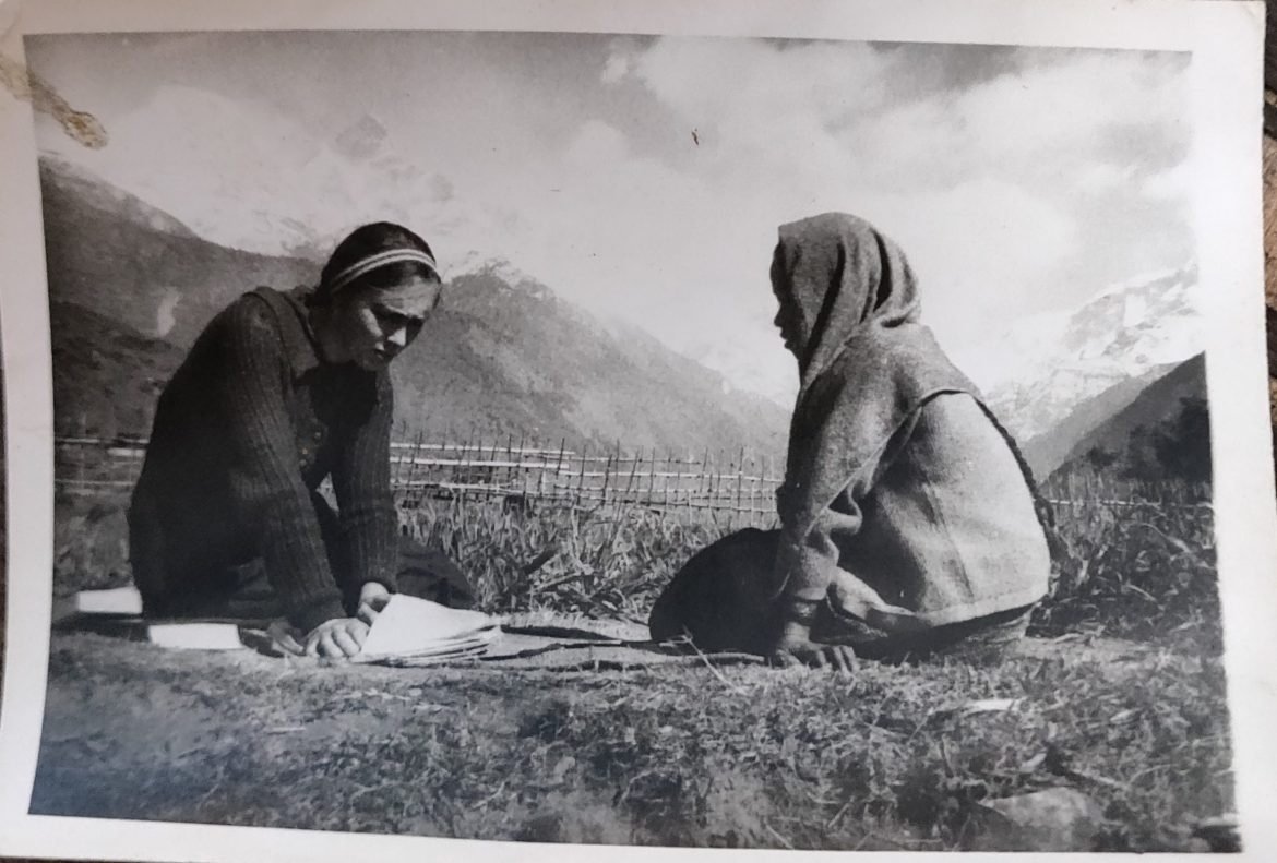 Two women read together in a Nepali village