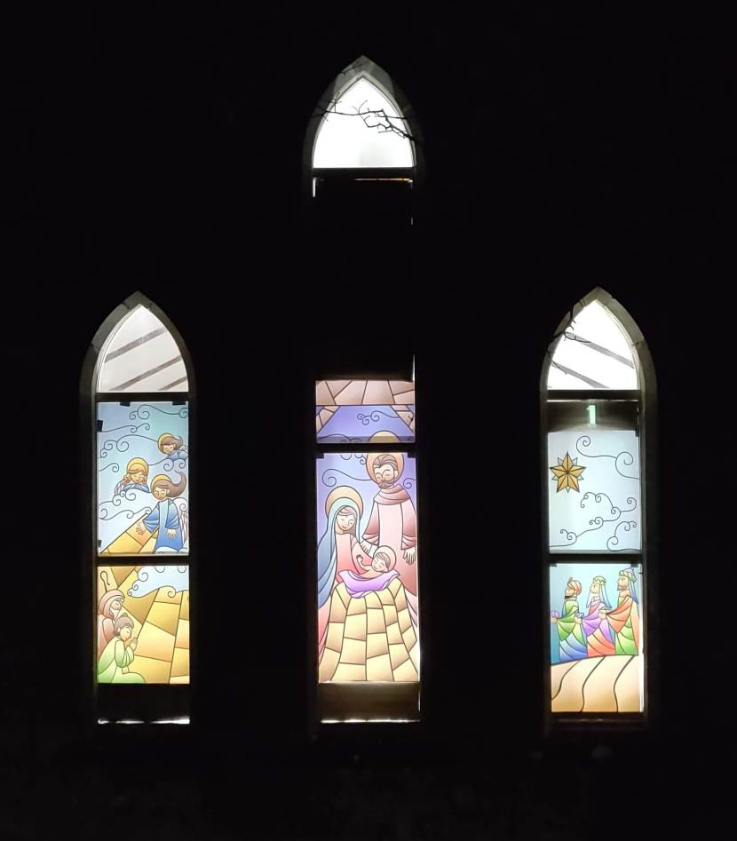 Stained glass nativity scene in church windows