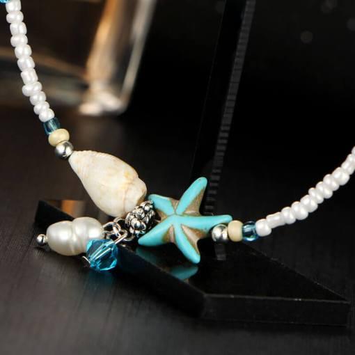 Chaine de cheville Océan étoile de mer vue sur etoile de mer et coquillage