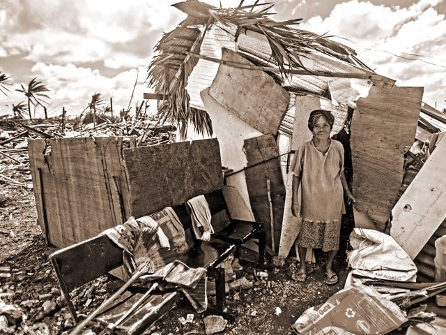 Hurricane woman in make shift house
