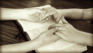 holding hands Bible prayer