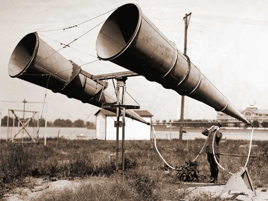Guy listening with big megaphones