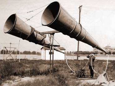 Guy listening with big megaphones