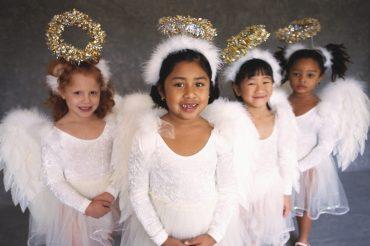 Little girls in angel costumes
