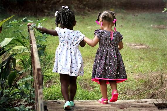 Girls walking across a bridge