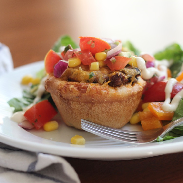 Baked Taco Cups - - A delicious roll, filled with taco meat and topped with your favorite Taco toppings!