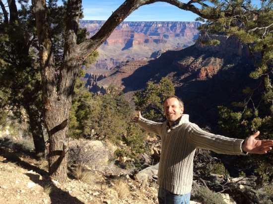 Man at edge of Grand Canyon
