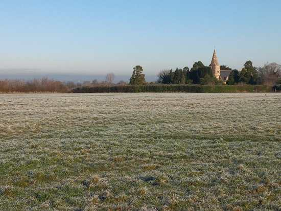 Frosty field with Church