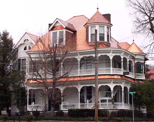 copper-shingles-roof-on-a-large-house