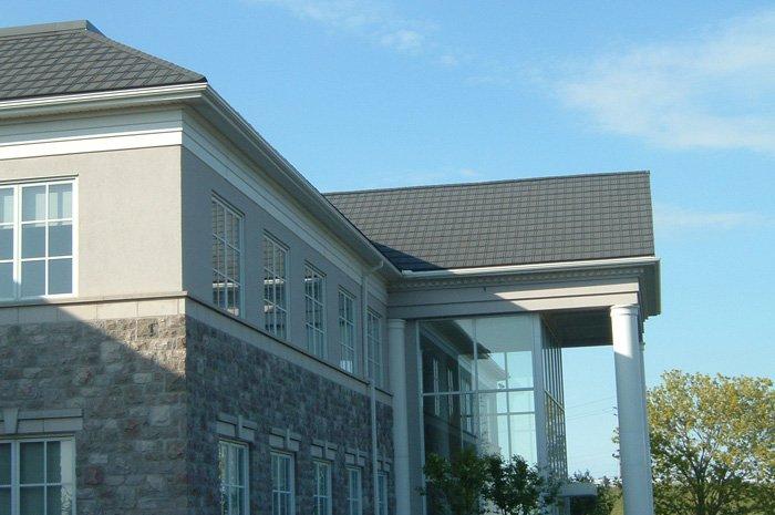 Dark metal slate roofing installed on an Ontario home