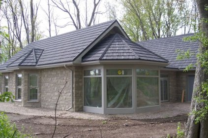 The contractor working on this secluded Ontario home knew they wanted a classic and natural look - which is why they chose fieldstone style brick and a steel shake roof from Metal Roof Outlet.