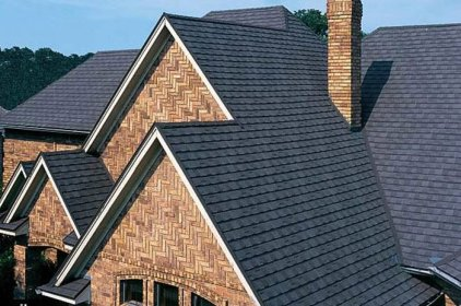 The unique brickwork on this Ontario home required a more traditional roof to anchor it, like this charcoal coloured shingle from Metal Roof Outlet.