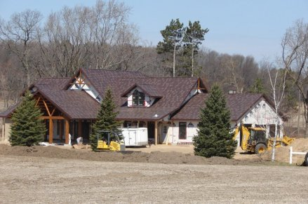 A newly built house with installed steel shake roofing