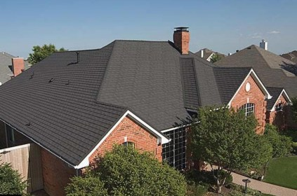 A dark coloured metal single roof on an Ontario home
