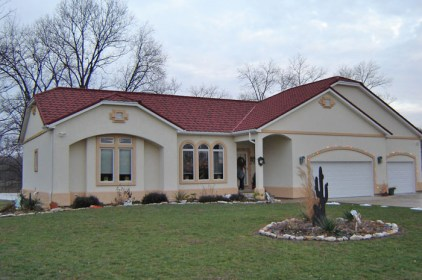 We love the look of stucco walls and a terra cotta, but to make it through all four Canadian seasons you need a tile-style metal roof from Metal Roof Outlet.