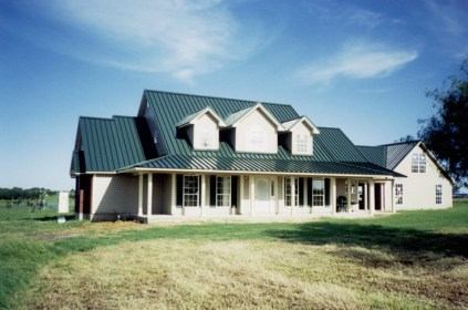 This rural Ontario home features a deep green steel sheet roof from Metal Roof Outlet.