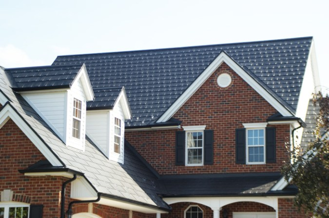 A home with an installed metal shingle roof by Metal Roof Outlet