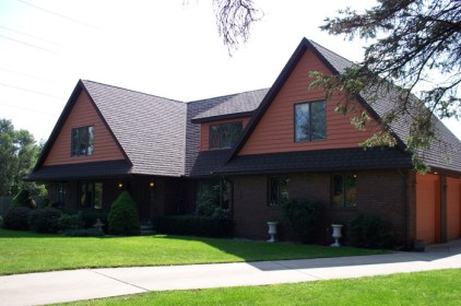 An Ontario home featuring a metal shingle roof