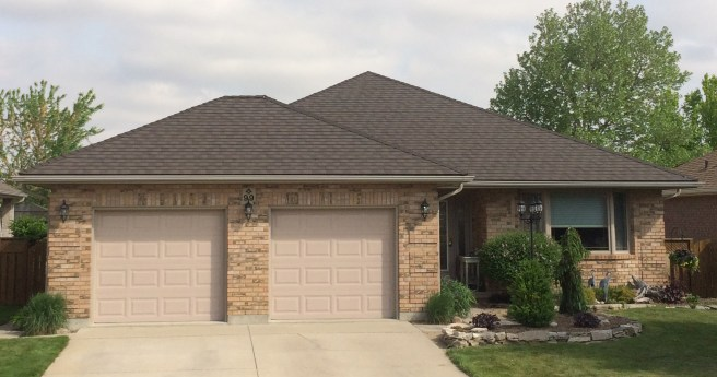 Steel Granite Ridge Shingle roof in the colour Ember installed in Chatham Ontario
