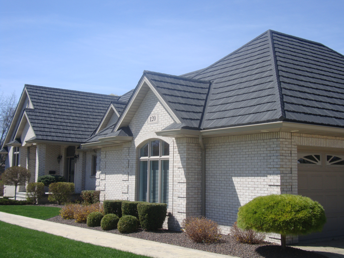 This Ontario homeowner chose a beautiful, dusty grey weathered wood-style steel shake roof from Metal Roof Outlet to offset airy white bricks.