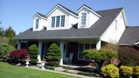 This Ontario family made the most of their gables by choosing steel shingle in the colour Onyx by Metal Roof Outlet.