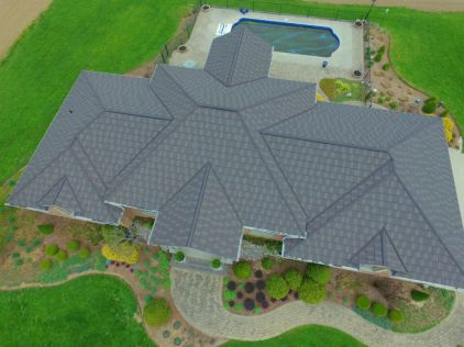 This sprawling home has many peaks and extensions, but Metal Roof Outlet's professional installation team had no problem covering it with a Steel Shake roof.