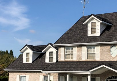 Charcoal coloured Boral Steel shingle roof in Chatham Ontario