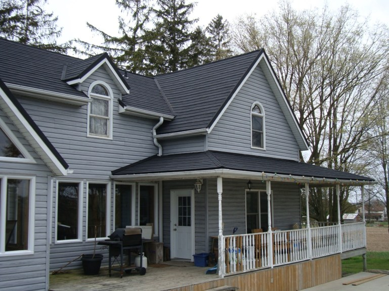 Steel metal shingle roofing on a country home in Chatham from Metal Roof Outlet