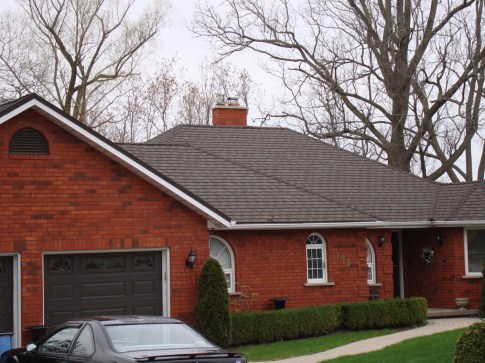 One-story bungalow featuring steel granite ridge shingle roofing by Metal Roof Outlet