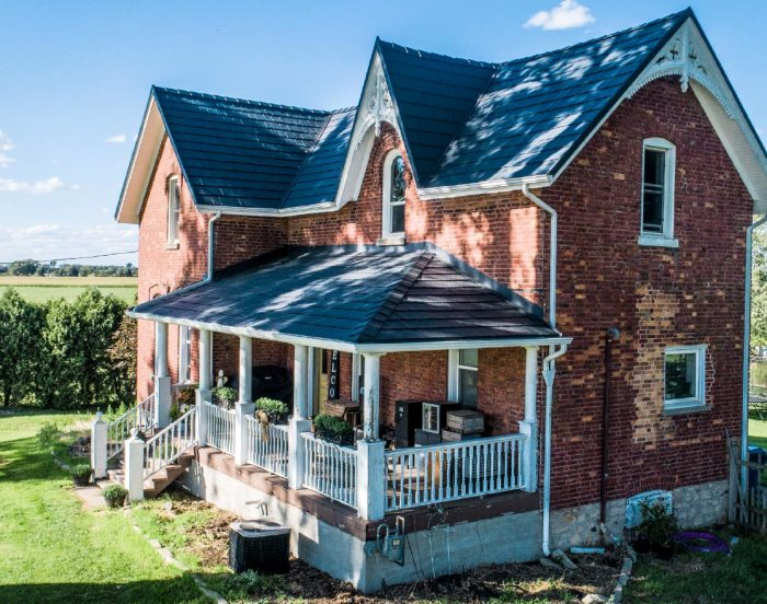 Deep Grey Metal Tile Resembles Slate Roof on red brick 1900s farmhouse