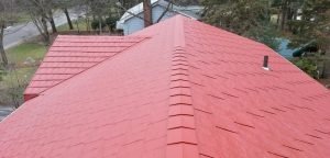 a red color metal shingles roof on a ranch house