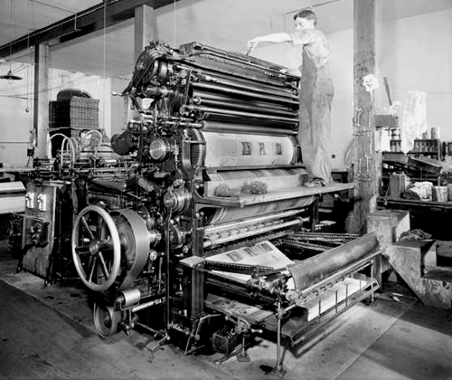 Two men working at a printing press at Smith-Brooks Printing Company in Denver, Colorado 1914.