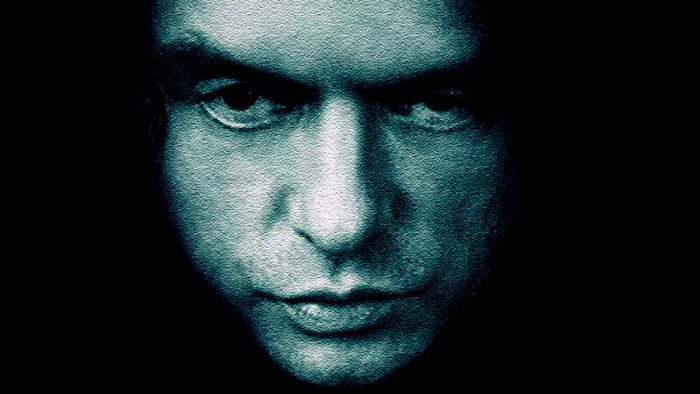 Tommy Wiseau's face on the room poster