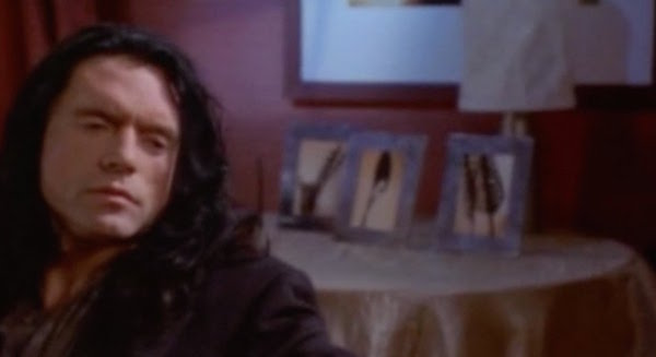 tommy wiseau sits in front of some spoons