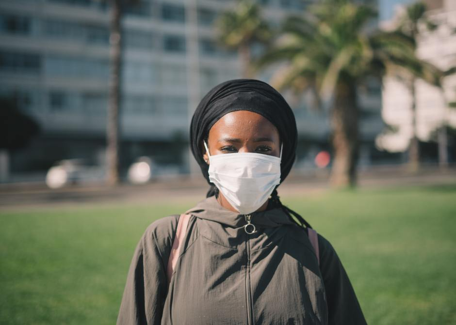 Woman wearing a facemask for blog by Metis HR on can I take employees off furlough