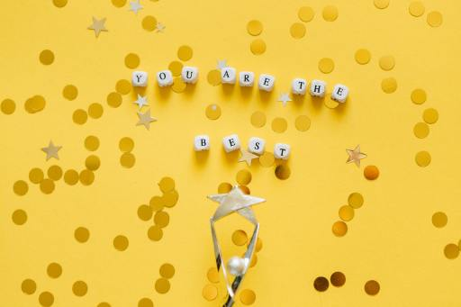 image of trophy on a yellow background for blog by Metis HR on employee rewards
