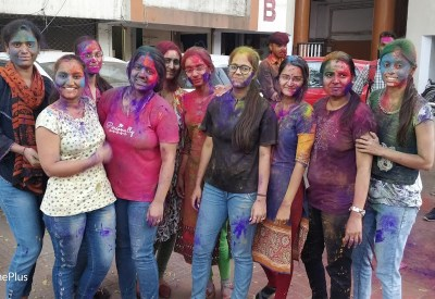 Metiz Girls Playing Holi
