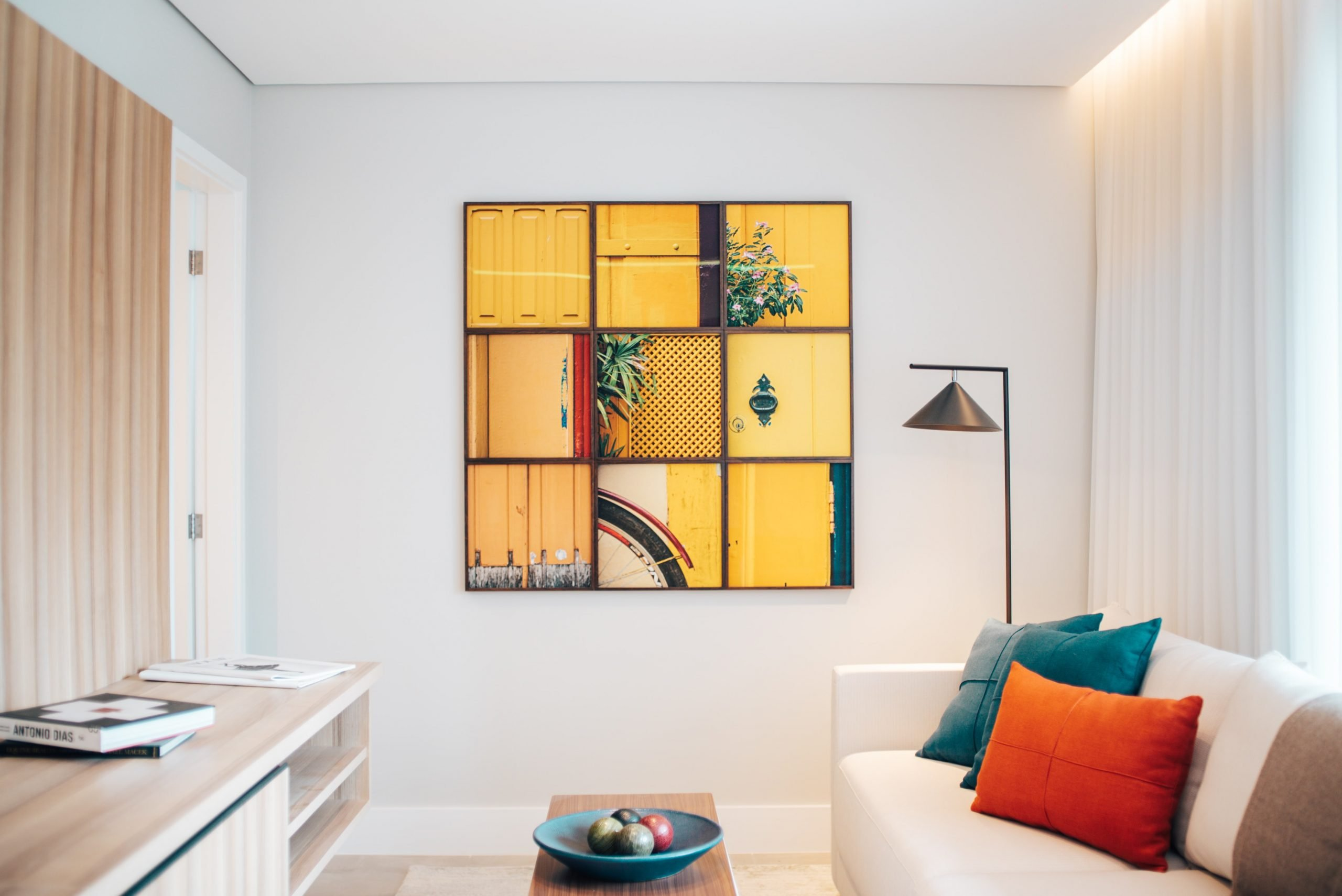 A room with a couch and art on the wall