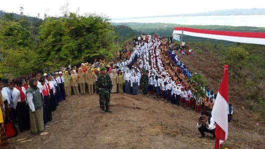 Upacara Hardiknas 2016 yang diikuti 1000 siswa di Perbatasan RI-Malaysia, tepatnya Kabupaten Nunukan, Pulau Sebatik.