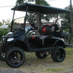 E-Z-GO RXV - Black and red lifted golf cart