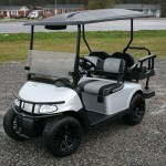 E-Z-GO RXV - Light silver metallic golf cart with black and grey diamond-stitched Elite Seats