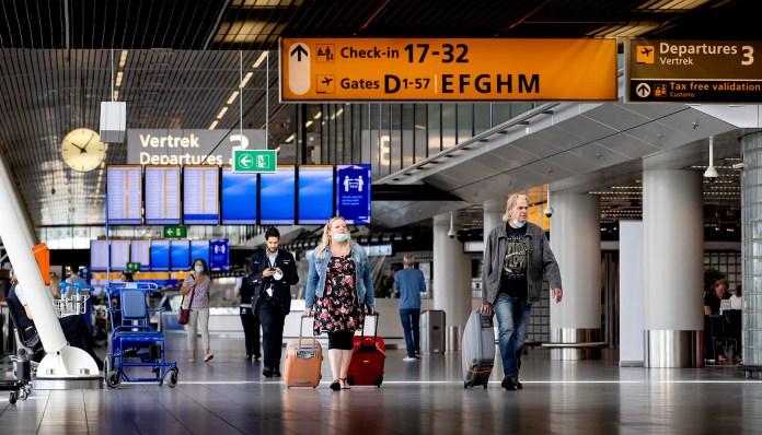 This photo shows travelers at Schiphol Airport. The number of flights has increased, since more European countries are accessible to Dutch people.