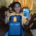 Students in Baseco, Manila receive almost a thousand World Vision school kits raised by Globe Platinum