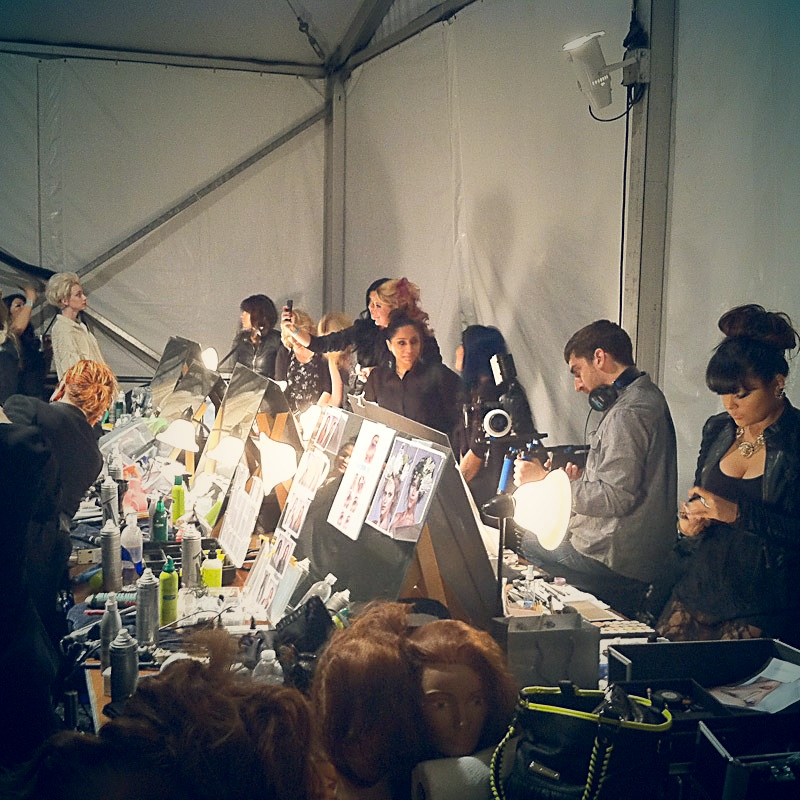 Backstage at the Fashion Focus Chicago 2012 headlining show where the 5 final contestants of Mario Make Me A Model competition getting ready along side Factor models.
