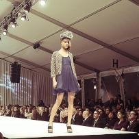 Mana Winkler, the finalist of Mario, Make Me A Model competition, facing the final challenge of walking the runway during the Fashion Focus Chicago week. Design by AZZA.